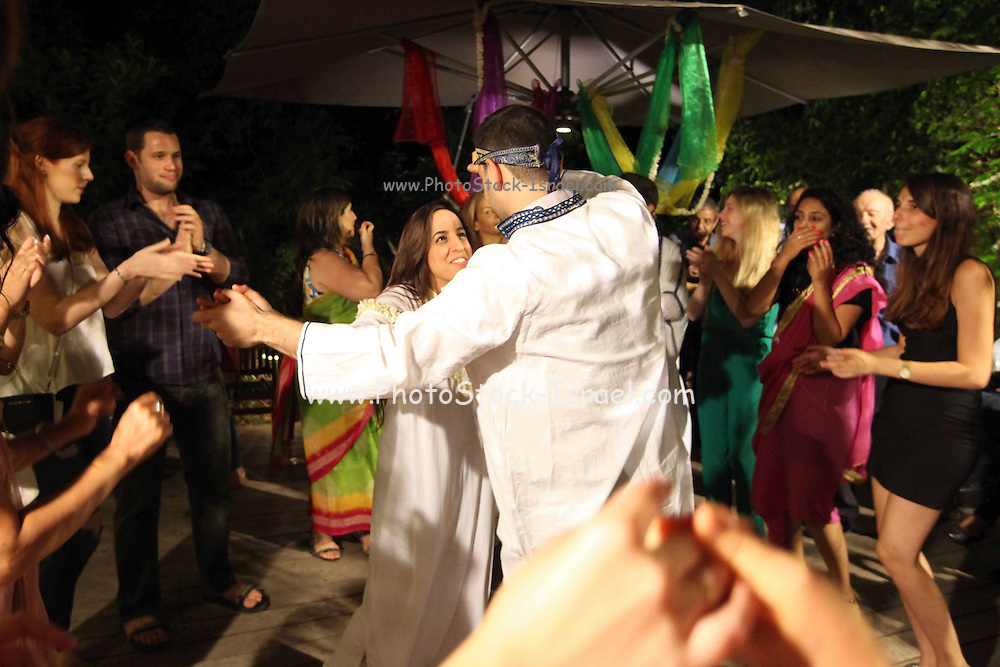 The bride and groom to be is dancing at their Mehndi (henna) ceremony, a traditional celebration befor the marriage ceremony