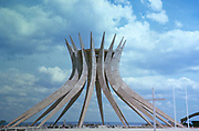 Modern architecture of the cathedral church building incomplete and under construction, Brasilia, Federal District, Brazil in 1962 architect Oscar Niemeyer