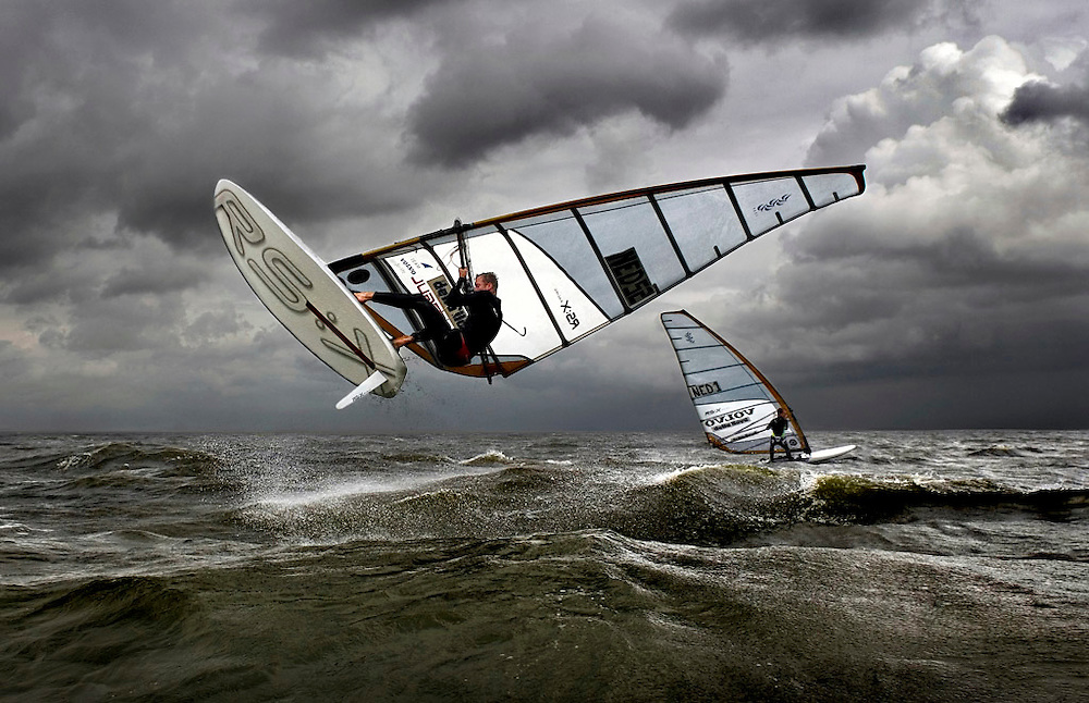 The Netherlands, Medemblik, 14-05-2007.<br /> Sailing, Windsurfing.<br /> In front Casper Bouman, the dutch world champion, is doing a jump. The other guy in the background is Joeri Passchier, the dutch number two of the last european championships.<br /> Photo: Klaas Jan van der Weij