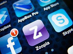 detail of iPhone 4G screen showing Zoopla property finding app