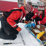Brenna McConnell, Metta Kaufman, and Cristina Galvan working on ice core samples from the Arctic Ocean.