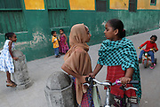 Two girls face off while playing in Stone Town in Zanzibar, Tanzania. Julia