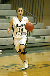 18 December 2004..Crystal Dye brings the ball up court...Illinois Wesleyan University Titans V Webster University Gorlocks.  NCAA Division III Women's Basketball.  Shirk Center, Illinois Wesleyan University, Bloomington IL