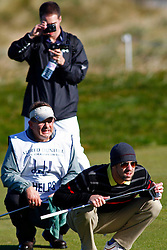 04.10.2012, Old Course, St. Andrews, SCO, European Golf Tour, Alfred Dunhill Links Championship, im Bild A course official takes a photo of Michael Phelps as he lines up a putt whilst // during the European Golf Tour, Alfred Dunhill Links Championship at the Old Course, St. Andrews, Scotland on 2012/10/04. EXPA Pictures © 2012, PhotoCredit: EXPA/ Mitchell Gunn