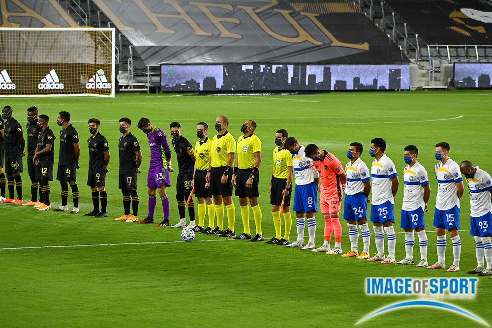 LAFC and San Jose Earthquakes players stand in a moment of silence in honor of the firefighters lost in recent California wildfires, before a MLS soccer game, Sunday, Sept. 27, 2020, in Los Angeles. The San Jose Earthquakes defeated LAFC 2-1.(Dylan Stewart/Image of Sport)