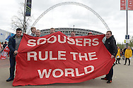 a Group of Liverpool fans hold up a 'Scousers Rule the World' flag outside Wembley Stadium before k/o. The FA Cup, semi final match, Aston Villa v Liverpool at Wembley Stadium in London on Sunday 19th April 2015.<br /> pic by John Patrick Fletcher, Andrew Orchard sports photography.