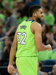 December 16, 2017 - Minneapolis, MN, USA - The Minnesota Timberwolves' Karl-Anthony Towns (32) reacts after a first-quarter dunk, forcing a timeout by the Phoenix Suns on Saturday, Dec. 16, 2017, at Target Center in Minneapolis. (Credit Image: © Aaron Lavinsky/TNS via ZUMA Wire)