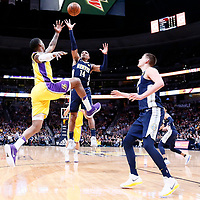 09 March 2018: Denver Nuggets guard Gary Harris (14) vies for the rebound with Los Angeles Lakers guard Kentavious Caldwell-Pope (1) in front of Denver Nuggets center Nikola Jokic (15) during the Denver Nuggets125-116 victory over the Los Angeles Lakers, at the Pepsi Center, Denver, Colorado, USA.