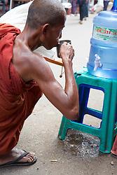 Monk Drinking Water At Thein Gyi Market
