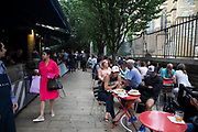 Outdoor seating at Brood restaurant in Borough Market in London, England, United Kingdom. Borough Market is a retail food market and farmers market in Southwark. It is one of the largest and oldest food markets in London, with a market on the site dating back to at least the 12th century. A farmers market is a physical retail marketplace intended to sell foods directly by farmers to consumers. Farmers markets may be indoors or outdoors and typically consist of booths, tables or stands where farmers sell fruits, vegetables, meats, cheeses, and sometimes prepared foods and beverages.