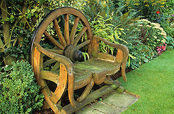 Seat made from old cartwheel.