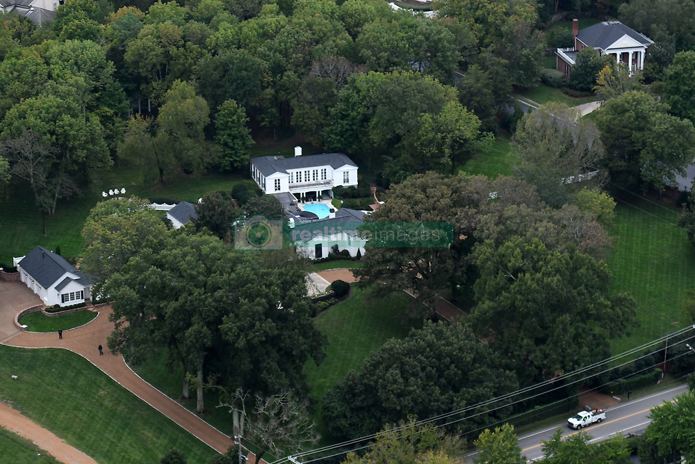 EXCLUSIVE: Aerial view of country singer Taylor Swift's historic 5601-square foot Northumberland Estate in Nashville, Tennessee. She purchased the 1934 Greek Revival estate, worth an estimated $3 million, in June 2011. It features a 5,600-square-foot main house with four bedrooms and four-and-a-half bathrooms. Out back there's a pool and a 2,000-square-foot guesthouse. The 28-year-old has a reported net worth of $280 million and huge chunk of that is parked in real estate. Swift owns more than $84 million worth of real estate across the US — eight properties in four different states, to be exact — according to estimates. As well as this country estate in Nashville, she also owns a 3,240-square-foot condo in Nashville's Music Row, which she bought at age 20. Ever the superstar, Swift also spends time in Los Angeles. She sold her Beverly Hills Cape Cod-style cottage of 2,826 square feet for $4 million earlier this year, but she still owns two more residences in the area — at least, for now. Her 2,950-square-foot Beverly Hills home is currently on the market; its value is estimated at $2.85 million. She also has an iconic 1934 Beverly Hills mansion she purchased in September 2015. It was previously home to Hollywood film producer, Samuel Goldwyn.Worth nearly $30 million, it's the most expensive piece of property in her real estate portfolio. Across the coast, Swift owns an estate with seaside views in Watch Hill, Rhode Island, valued at $6.65 million.The seven-bedroom, nine-bathroom mansion of 12,000 square feet overlooks 700 feet of shoreline with views of Block Island Sound and Montauk Point. In 2014, Swift put her savvy real estate skills to work, purchasing two adjacent penthouses in a Tribeca building and renovating them into one large duplex penthouse of 8,309 square feet with 10 bedrooms and 10 bathrooms. It features an expansive kitchen where Swift has baked with her squad, a billiards table, and a sweeping staircase, all at an estimated value of $20.5 mi