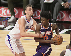 December 20, 2017 - Los Angeles, California, U.S - Josh Jackson #20 of the Phoenix Suns  drives for a basket during their NBA game with the Los Angeles Clippers  on Wednesday December 20, 2017 at the Staples Center in Los Angeles, California. Clippers vs Suns. (Credit Image: © Prensa Internacional via ZUMA Wire)