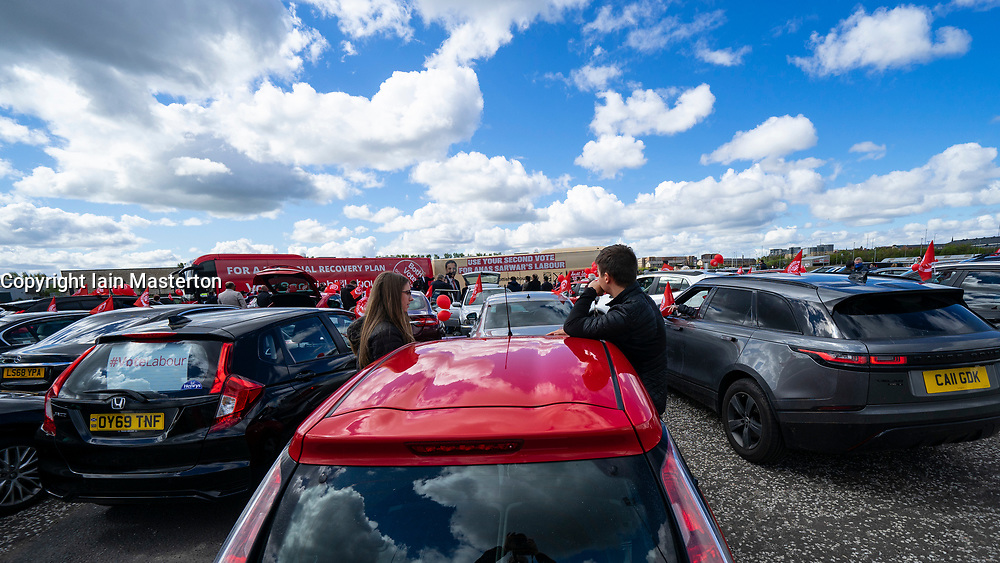 Glasgow, Scotland, UK. 5 May 2021. Scottish Labour Leader Anas Sarwar and former Prime Minister Gordon Brown appear at an eve of polls drive-in campaign rally in Glasgow today. Supporters listen to rally in cars.  Iain Masterton/Alamy Live News