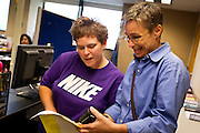 MADISON, WI - JUNE 11, 2014: Renee Currie and Shari Roll smile as they read through their certificate of marriage at the Dane County Register of Deeds. Currie and Roll were the first same sex couple to be legally wed in the state of Wisconsin on Friday, June 6, 2014.