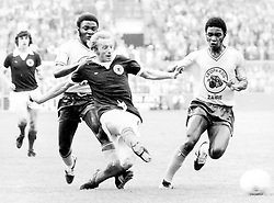 Scotland's Denis Law (c) gets in a shot before Zaire's Boba Lobilo (r) can tackle
