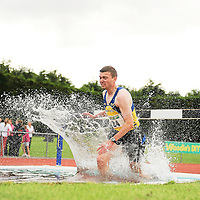 14 August 2010; Rory Chesser, Clare County, makes a big splash during the Men's 300m Premier Division Steeplechase at the Woodie's DIY National League Final 2010. Tullamore Harriers Stadium, Tullamore, Co. Offaly. Picture credit: Barry Cregg / SPORTSFILE *** NO REPRODUCTION FEE ***
