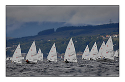 Opening races in breezy conditions for the Laser Radial World Championships, taking place at Largs, Scotland GBR. ..118 Women from 35 different nations compete in the Olympic Women's Laser Radial fleet and 104 Men from 30 different nations. .All three 2008 Women's Laser Radial Olympic Medallists are competing. .The Laser Radial World Championships take place every year. This is the first time they have been held in Scotland and are part of the initiaitve to bring key world class events to Britain in the lead up to the 2012 Olympic Games. .The Laser is the world's most popular singlehanded sailing dinghy and is sailed and raced worldwide. ..Further media information from .laserworlds@gmail.com.event press officer mobile +44 7775 671973  and +44 1475 675129 .