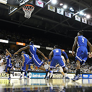 Central Florida guard Marcus Jordan (5) drives to the basket against the entire Memphis team during a Conference USA NCAA basketball game between the Memphis Tigers and the Central Florida Knights at the UCF Arena on February 9, 2011 in Orlando, Florida. Memphis won the game 63-62. (AP Photo: Alex Menendez)