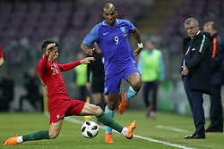 (L-R) Joao Cancelo of Portugal, Ryan Babel of Holland, coach Fernando Santos of Portugal during the International friendly match match between Portugal and The Netherlands at Stade de Genève on March 26, 2018 in Geneva, Switzerland