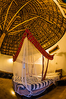 Guest room with bed covered by a mosquito net, Kanta Lodge, Konso, Southern Nations Nationalities and People's Region, Ethiopia.
