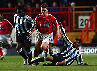 Scott Parker (Charlton) is tackled by Olivier Bernard and Nolberto Solano (Newcastle) Charlton v Newcastle, The Valley, 20/12/2003, Premiership Football. Credit : Colorsport / Robin Hume. Digital File Only.