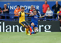 Football - 2016/2017 Premier League - Leicester Ciity V Arsenal. <br /> <br /> Danny Simpson of Leicester City gets a tackle in front of Alex Oxlade-Chamberlain of Arsenal at The King Power Stadium.<br /> <br /> COLORSPORT/DANIEL BEARHAM