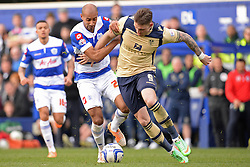QPR's Karl Henry and Leeds United's Connor Wickham compete for the ball - Photo mandatory by-line: Mitchell Gunn/JMP - Tel: Mobile: 07966 386802 01/03/2014 - SPORT - FOOTBALL - Loftus Road - London - Queens Park Rangers v Leeds United - Championship