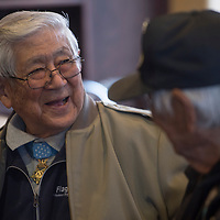 Medal of Honor recipient Hiroshi Miyamura laughs and talks with Navajo code talker Roy Hathorne during a veterans dinner at Comfort Suites in Gallup Thursday.