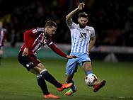 Billy Sharp of Sheffield United in action with Jordan Turnbull of Coventry City during the English League One match at the Bramall Lane Stadium, Sheffield. Picture date: April 5th, 2017. Pic credit should read: Jamie Tyerman/Sportimage