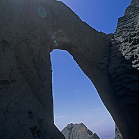 A mountaineer stands below Shipton's Arch, one of the world's largest natural bridges, in the arid Kara Tagh Mountains next to the Taklimakan Desert near Kashagar (Kashi) in Xinjiang Province, China.