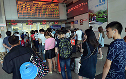 September 14, 2016 - Fuzhou, Fujian, China - The passengers refund the tickets in queue for many trains shutted down affected by the coming super typhoon Meranti at the railway station in Fuzhou,Fujian,China on 14th September 2016. (Credit Image: © TPG via ZUMA Press)