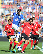Everton's Kevin Mirallas © battles for the ball with Cardiff's Peter Whittingham. Barclays Premier league, Cardiff city v Everton at the Cardiff city Stadium in Cardiff,  South Wales on Saturday 31st August 2013. pic by Andrew Orchard,  Andrew Orchard sports photography,