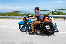 Kyle Rose riding down the highway during the Cross Country Chase motorcycle endurance run from Sault Sainte Marie, MI to Key West, FL. (for vintage bikes from 1930-1948). Stage-10 covered 110 miles from Miami to the finish in Key West, FL USA. Sunday, September 15, 2019. Photography ©2019 Michael Lichter.