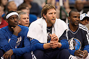 Dirk Nowitzki (41) of the Dallas Mavericks sits between teammates Anthony Morrow (23), left, and Mike James (13), right as the Mavericks host the Los Angeles Lakers at the American Airlines Center in Dallas on Sunday, February 24, 2013. (Cooper Neill/The Dallas Morning News)