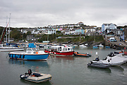 Harbour in New Quay, Ceredigion, Wales, United Kingdom. New Quay is a seaside town in Ceredigion, Wales located on Cardigan Bay with a harbour and large sandy beaches, it lies on the Ceredigion Coast Path, and remains a popular seaside resort and traditional fishing town.