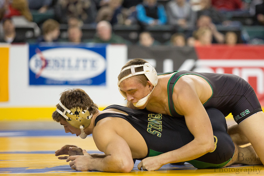 Rory Bonner of West Deptford defeats .Matt Moore of Brick Memorial (green stripe) in the 195 lb 3rd place match in the NJ State Wrestling Tournament at Boardwalk Hall in Atlantic CIty, NJ on Sunday March 10, 2013. (photo / Mat Boyle)