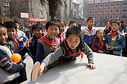 Boys play table tennis in the playground of a primary school in Hong Ying Road, Xian, China