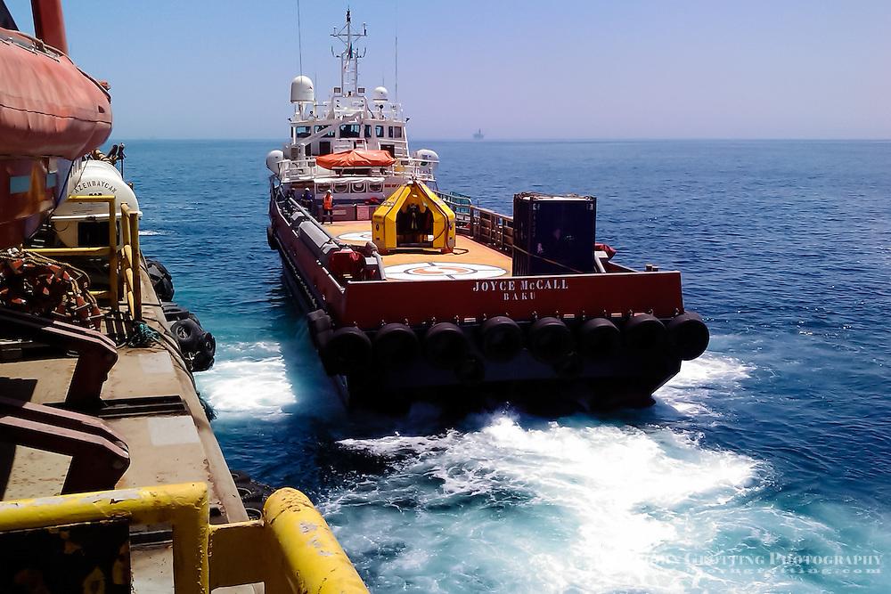 Azerbaijan. Caspian Sea. A personnell transport alongside DBA at a Caspian oil field.