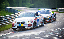 Touring cars at the Brünnchen corner, take part in the GT ADAC Zurich 24h race endurance racing event on the Nordschleife (north loop) of the Nürburgring in central Germany at Nürburgring, Germany.
