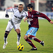 Besiktas's Mert NOBRE (L) and Trabzonspor's Hrvoje CALE (R) during their Turkish Superleague Derby match Besiktas between Trabzonspor at the Inonu Stadium at Dolmabahce in Istanbul Turkey on Sunday, 06 March 2011. Photo by TURKPIX