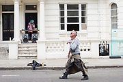 A man dances to a live DJ during The Notting Hill Carnival on the 27th August 2018 in London in the United Kingdom. The Notting Hill Carnival is an annual event held over two days of the August Bank Holiday weekend. It has taken place in London since 1966 on the streets of Notting Hill, in the Royal Borough of Kensington and Chelsea and the City of Westminster.