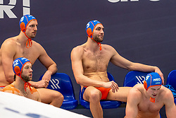 Thomas Lucas, Jesse Nispeling, Guus van IJperen, Guus Wolswinkel of the Netherlands disappointed against Montenegro during the Olympic qualifying tournament. The Dutch water polo players are on the hunt for a starting ticket for the Olympic Games on February 19, 2021 in Rotterdam