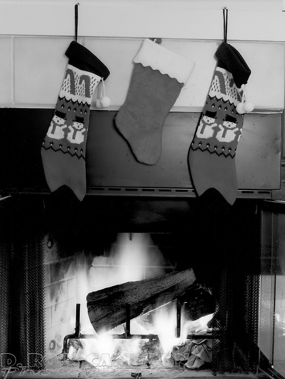 Christmas stockings are hung by the fireplace at the photographer's home in Pleasanton, Calif., seen Dec. 16, 1995. (Photo by D. Ross Cameron)