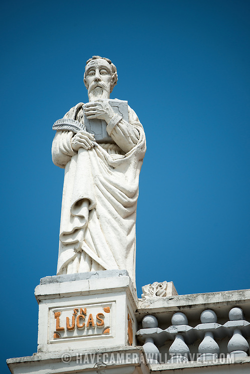 Statue of Saint Luke that sits atop the Iglesia de Xalteva. The Barque styled Iglesia de Xalteva, in the western part of Granada, was originally built in the 19th century, but it has been destroyed and rebuilt several times since, most recently in 1921.
