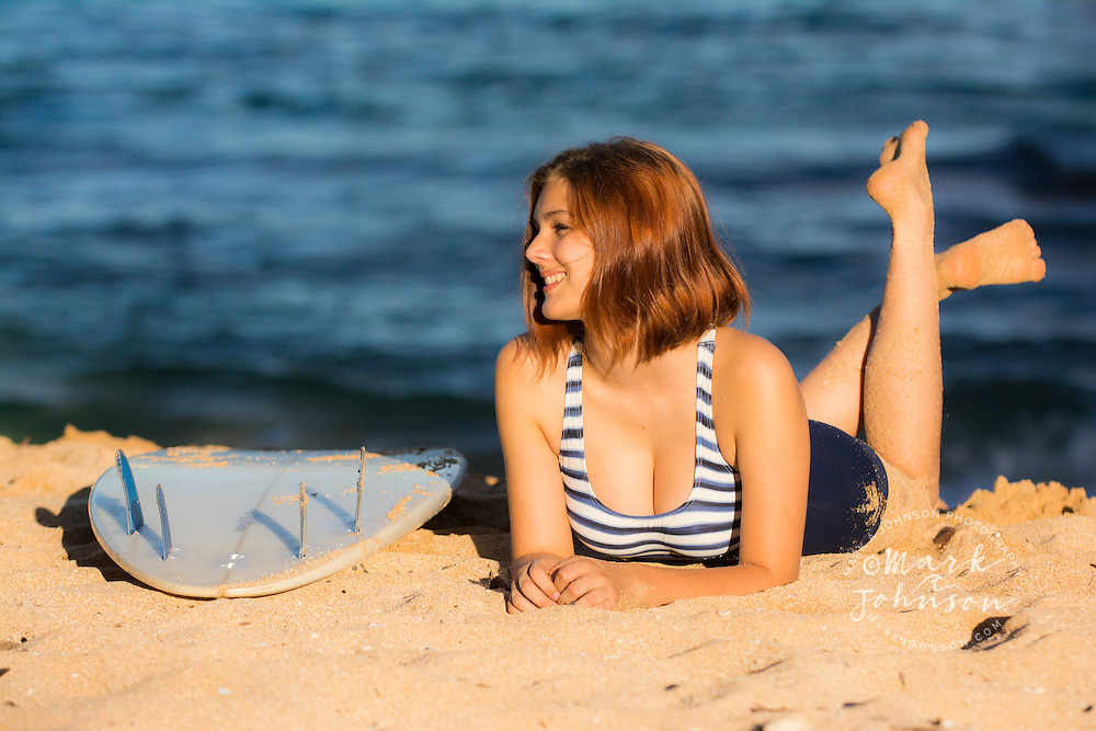 Young woman surfer at the beach