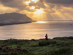 Man trail running in front of port of Bilbao