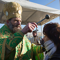 Believers kiss the cross after a greek catholic priest sanctified the water of river Danube and washed the cross in it on the occasion of Epiphany in central Budapest, Hungary on January 06, 2017. ATTILA VOLGYI
