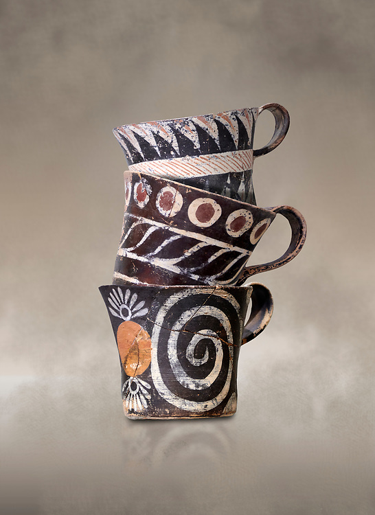 """Minoan Kamares """"eggshell"""" ware cups with  with  polychrome decorations, from set found at Phaistos Palace 1800-1600 BC; Heraklion Archaeological  Museum.<br /> <br /> These cups found as parts of sets in Phaistos palace were names """"eggshell"""" ware due to the very thin walls of the cups. This style of pottery is named afetr Kamares cave where this style of pottery was first found .<br /> <br /> If you prefer to buy from our ALAMY PHOTO LIBRARY  Collection visit : https://www.alamy.com/portfolio/paul-williams-funkystock/minoan-art-artefacts.html . Type -   Heraklion   - into the LOWER SEARCH WITHIN GALLERY box. Refine search by adding background colour, place, museum etc<br /> <br /> Visit our MINOAN ART PHOTO COLLECTIONS for more photos to download  as wall art prints https://funkystock.photoshelter.com/gallery-collection/Ancient-Minoans-Art-Artefacts-Antiquities-Historic-Places-Pictures-Images-of/C0000ricT2SU_M9w"""