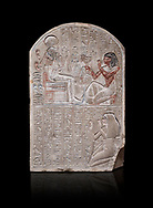 Ancient Egyptian stele dedicated to the god Khonsu by draftsman Pay, limestone, New Kingdom, 19th Dynasty, (1279-1213 BC), Deir el-Medina, ODrovetti cat 1553. Egyptian Museum, Turin. black background, .<br /> <br /> If you prefer to buy from our ALAMY PHOTO LIBRARY  Collection visit : https://www.alamy.com/portfolio/paul-williams-funkystock/ancient-egyptian-art-artefacts.html  . Type -   Turin   - into the LOWER SEARCH WITHIN GALLERY box. Refine search by adding background colour, subject etc<br /> <br /> Visit our ANCIENT WORLD PHOTO COLLECTIONS for more photos to download or buy as wall art prints https://funkystock.photoshelter.com/gallery-collection/Ancient-World-Art-Antiquities-Historic-Sites-Pictures-Images-of/C00006u26yqSkDOM